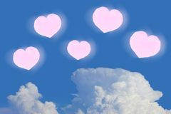Pink hearts icons in the air. Cloud and blue sky background Royalty Free Stock Photos