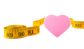 Pink hearts and inch tape Stock Photography