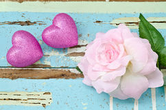 Pink hearts and pink roses on grungy light blue wooden Stock Photography