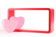 Pink hearts with red wooden frame Royalty Free Stock Photography