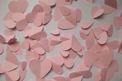 Pink hearts on a white background Stock Photos
