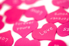 Pink hearts on the white background. Stock Photos