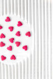 Pink hearts on white plate Stock Image