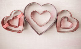 Pink Hearts on Wood Background Stock Photo