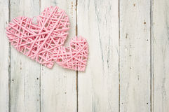 Pink hearts on a wooden background Royalty Free Stock Images