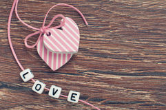 Pink hearts on wooden board Royalty Free Stock Images