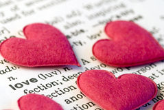 Pink hearts on word love Royalty Free Stock Photography