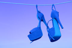 Pink heels on a rope Royalty Free Stock Photos