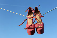 Pink heels on a wire Stock Photos