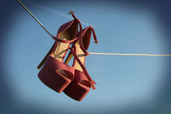 Pink heels on a wire Royalty Free Stock Image