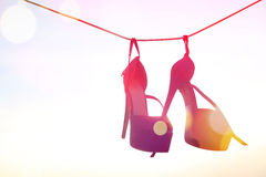 Pink heels on a wire Stock Images