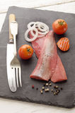 Pink herring with tomato and onion Stock Photo