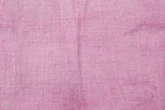 Pink hessian fabric texture background. Blank pink pattern background stock photo