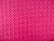 Pink hexagon surface background. Plastic texture Royalty Free Stock Image