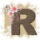 Pink hibiscus vintage alphabet R. Pink hibiscus grunge vintage alphabet R Stock Photos