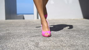 Pink high heel shoes stock footage