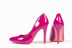 Pink high heels. Sexy pink shoes high heels are on white background Stock Image