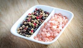 Pink himalayan salt and peppers Royalty Free Stock Photos