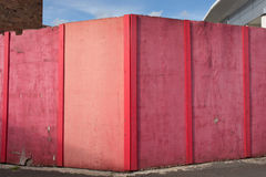 Pink hoarding. Hoarding, painted pink, enclosing a building site stock image