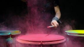 Pink holi powder drum , slow motion. black background. stock video footage