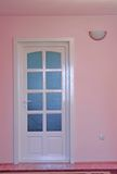 Pink home interior with door. And lamp Stock Image