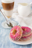 Pink homemade donuts with Latte Macchiatto Stock Photos