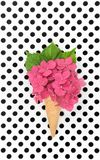 Pink hortensia flower ice cream waffle. Pink hortensia flower in ice cream waffle cone on polka dot background Royalty Free Stock Photography