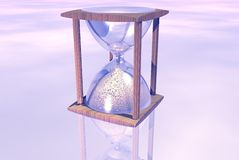 Pink Hourglass. Wooden hourglass over abstract pink scenery Royalty Free Stock Photography