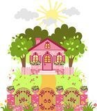 Pink house. With a garden and a fence Stock Photos