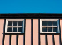 Pink house. Striking pink house and a bright blue sky Royalty Free Stock Photo