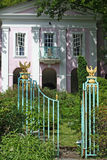 A pink house. Elaborate gates invite you into the pink house Royalty Free Stock Image