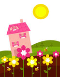 Pink house behind spring flowers Royalty Free Stock Photos
