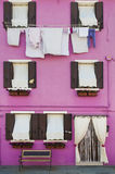 Pink house, bench, drying clothes, Burano, Italy Royalty Free Stock Photos