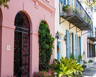 Pink House and Blue Shutters Stock Photo