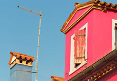 Pink house and blue sky Stock Photography