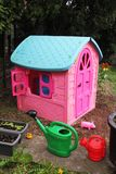 Pink house for children in a garden Royalty Free Stock Image