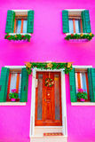 Pink house with christmas decoration on the island Burano, Venic Stock Image