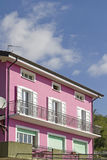 Pink house. Pink colored dwelling house in Friuli, by its color a true eyecatcher Stock Photos
