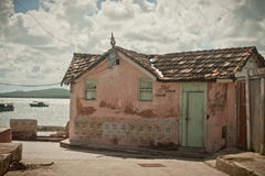 Pink house in Cuba. Pink house by the sea in Holguin, Cuba Royalty Free Stock Photography