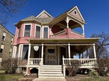 Pink House in Elgin. This is a Winter picture of the James A. palmer house located in Elgin, Illinois in Kane County. This house is an example of Queen Anne stock image
