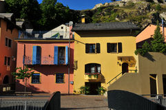 Pink house and green house. Coulourful houses in the old town of Sion, Switzerland Stock Photo