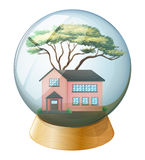 A pink house inside the crystal ball Stock Images