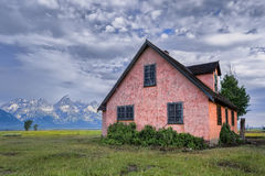 The Pink House on Mormon Row. Pink stucco house, now abandoned, on Mormon Row in Grand Teton National Park, WY Royalty Free Stock Image