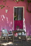 Pink house with pink window, typical colorful of Trancoso Stock Images