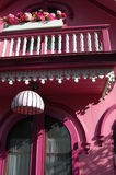 Pink house with railing Royalty Free Stock Photo