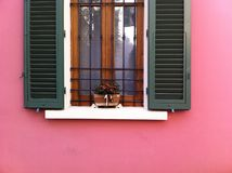 Pink house. Window with flower end pink Royalty Free Stock Photos