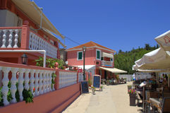 Pink houses and outdoor restaurant seating Royalty Free Stock Image
