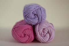Pink hues rolls of yarn for crochet or knit. Horizontal shot of lovely range of cotton in bright, soft, baby girl colors for creative and relaxing hobbies Stock Photo