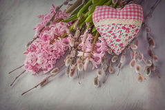 Pink hyacinth, willow twigs and  heart Stock Photography