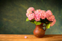 Pink hydrangea in a ceramic vase Royalty Free Stock Images